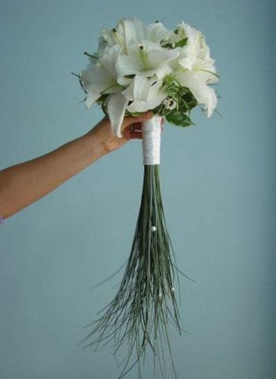 фото: Букет невесты из лилий - поистине шикарное украшение